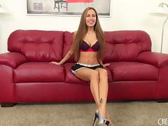 Pretty Amia Miley models her outfit and cums on her cam