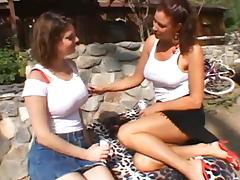 Busty lesbian MILFs