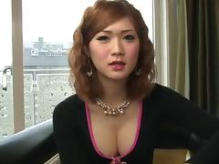 Japanese tgirl cock looks hard and sexy in a hotel room