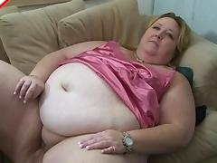 Fatty in sexy pink satin lingerie sucks on a hard dick