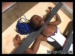 Ebony-skinned chick with a hot body locked in restraints