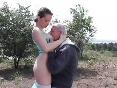 Slutty girl and a horny grandpa fucking in the grass