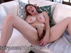Eleanor Rose using a toy on her hairy pussy