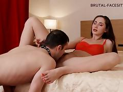 Black-haired mistress Cassidy takes a leak on her slave's face