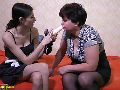 Mature lady enjoying lesbian strapon