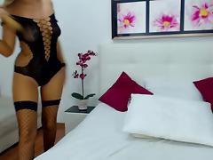 Busty long legged camgirl spreads her legs and plays