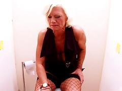 Blonde granny immediately sucks the cock peeking through the hole