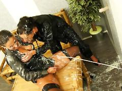 Girls in black satin play with big toys that shoot cum