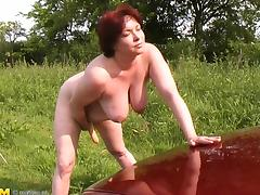 Superb seen of matured bimbo masturbating using toy outdoor