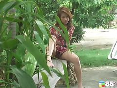 Tropical beauty decides to show her shaved beaver to the camera