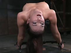 Bound black-haired chick has to suck the dick of her captor