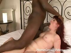 Mature redhead slut gets her pussy pumped with a BBC