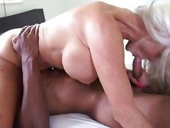 Busty granny enjoys riding hard on a massive black shaft