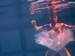 Sensual Russian redhead removes her clothes under the water