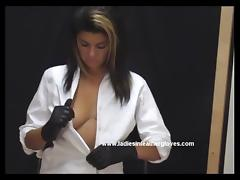 Busty babe gets naked and puts on sexy lingerie and gloves