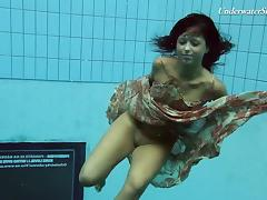 Russian teen diving while showing off her natural tits