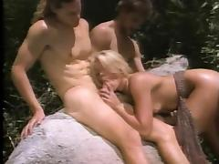 Retro beauty called Krysti is surrounded by cocks in the wilderness