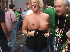 Blonde with a big pair of tits is acting naughty with her friends