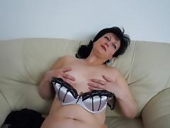 Chubby mature hussy Julie enjoys masturbating on a couch