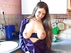 Young babe with hot saggy tits playing in the kitchen