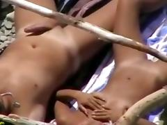 Outdoor voyeur video of nude couple on beach