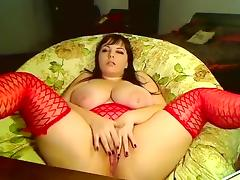 Busty brunette milf on webcam fingering her wide wet pussy