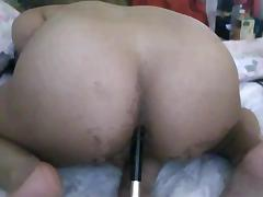 Tranny using a brush as a dildo