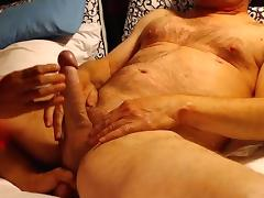 wife tugs balls for explosive cumshot , lands on shoulder