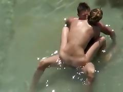 Nudist couple secretly filmed fucking in the water