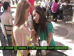 Faye and Larysa tender two hot babes at a table outside