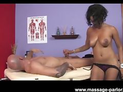 Big tits ebony masseuse gives super hot handjob
