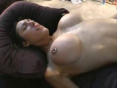 Brunette with pierced plastic tits sucks cock then climbs aboard dudes dick
