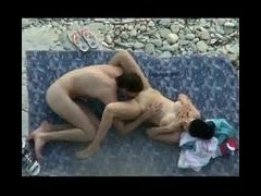 sex on the beach Young couple spied on with peeping cam They play in the water naked and this babe h