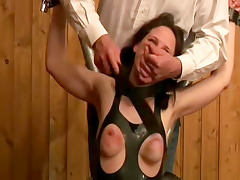 She wears tight rubber in rope bondage