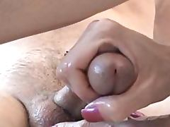 Sexy Brunette Gives a Great Footjob
