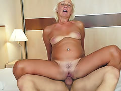 Kate Blonde with hairy cunt is satisfying her muscular macho