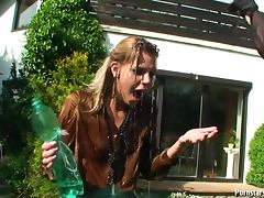 Water fight outdoors with sexy chicks