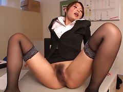 Office girl Risa Kotani gives a blowjob and a footjob before riding a cock