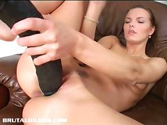 Suzie fills her pussy with a giant dildo