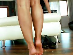 Foot fetish masturbating big titted babe on love seat