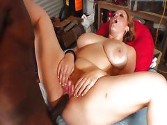 Redhead interracial fuck in the garage