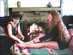 Lesbians who love big tits eat pussy in front of fireplace