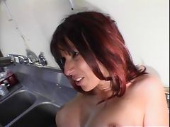 Hot redhead in action at a convenience store