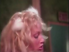 Curly haired blonde in white lace gets fucked behind the scenes