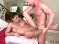 Gay masseur having anal sex with a muscled stud