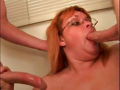 Skanky older broad sucks young dude's cock then takes a big facial