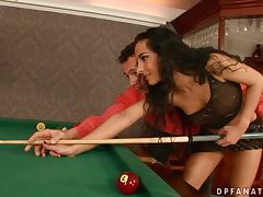 Brunette Babe Janet Joy Playing Pool with Two Big Cues