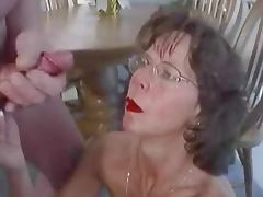 Mature brunette in glasses cherishes huge facial cumshot