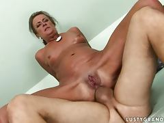 Lewd granny Sandora gets her holes fingered and fucked hard
