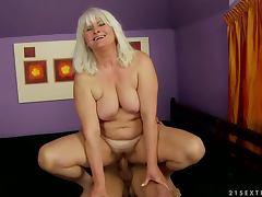 Nasty granny Judi sucks and deepthroats a cock before riding it